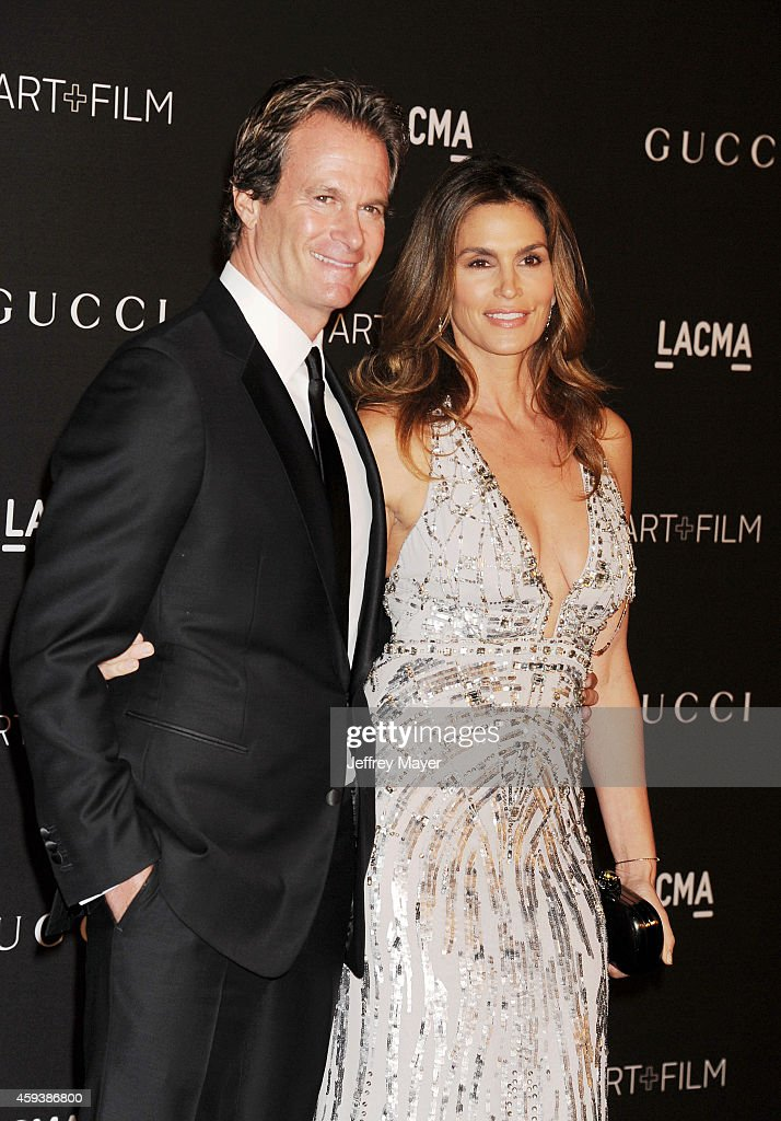 Rande Gerber (L) and model Cindy Crawford attend the 2014 LACMA Art + Film Gala honoring Barbara Kruger and Quentin Tarantino presented by Gucci at LACMA on November 1, 2014 in Los Angeles, California.