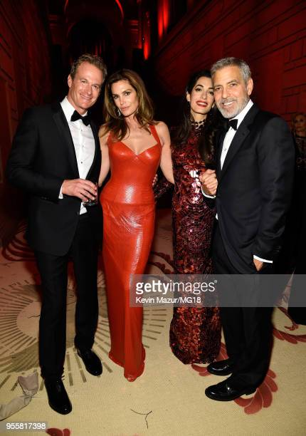 Rande Gerber Cindy Crawford Amal Clooney and George Clooney attend the Heavenly Bodies Fashion The Catholic Imagination Costume Institute Gala at The...