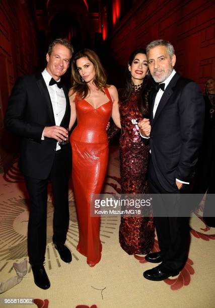Rande Gerber, Cindy Crawford, Amal Clooney, and George Clooney attend the Heavenly Bodies: Fashion & The Catholic Imagination Costume Institute Gala...