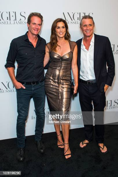 Rande Gerber, Cindy Crawford and Russell James attend the Russell James 'Angels' book launch & exhibit at Stephan Weiss Studio on September 6, 2018...