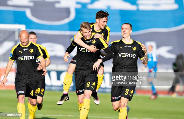 Randers FC's Simon Piesinger celebrates scoring the opening goal with his teammates during the 3F Super League football match between AGF and Randers...