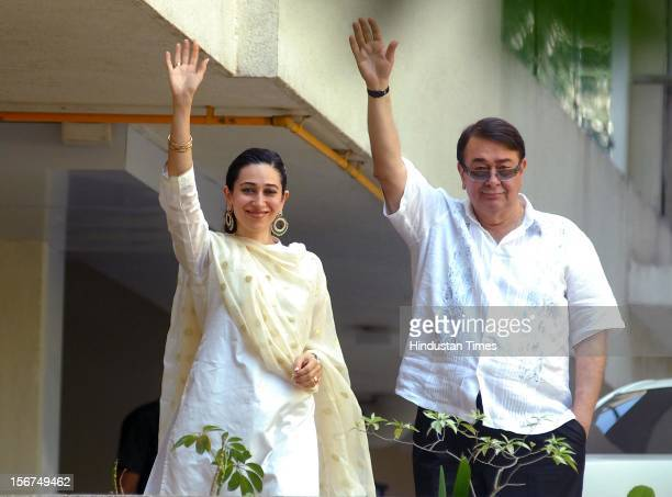 MUMBAI INDIA OCTOBER 16 Randhir Kapoor and Karisma Kapoor appear on the balcony after the SaifKareena's registry marriage at Fortune Heights Saif's...