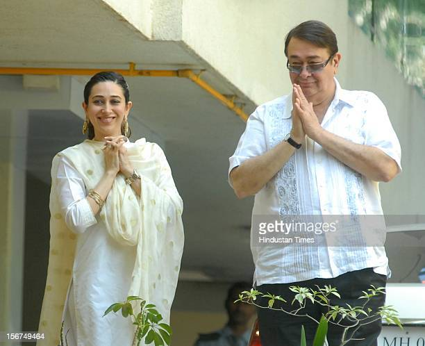 Randhir Kapoor and Karisma Kapoor appear on the balcony after the Saif-Kareena's registry marriage at Fortune Heights, Saif's residence in Bandra on...