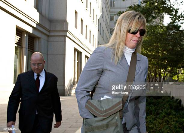 Randi Collotta right, leaves Manhattan federal court with her husband Christopher, left, in New York, U.S. Following a sentencing hearing on...