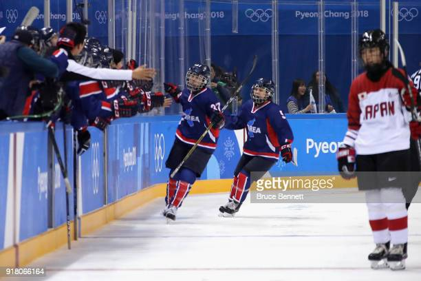 Randi Griffin of Korea celebrates after scoring a goal in the second period against Japan during the Women's Ice Hockey Preliminary Round Group B...