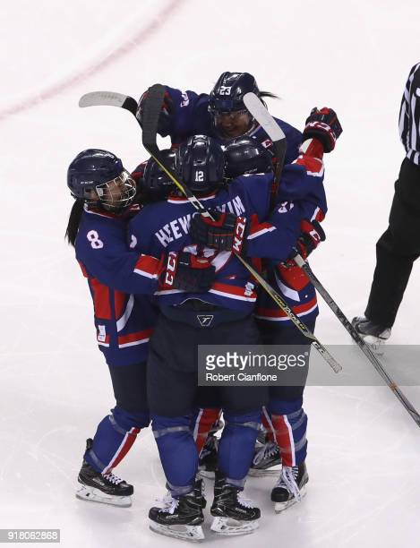 Randi Heesoo Griffin of Korea celebrates after she scored during the Women's Ice Hockey Preliminary Round Group B game between Korea and Japan on day...