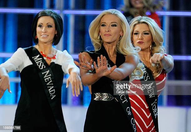 Randi Sundquist Miss Nevada Allyn Rose Miss District of Columbia and Mallory Hytes Hagan Miss New York perform during the opening of the 2013 Miss...