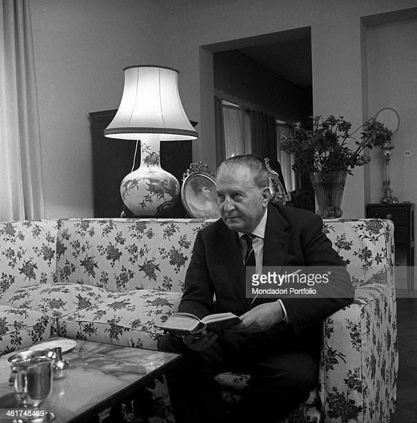 Randolfo Pacciardi is sitting on the sofa of his living room, with an open book in his hands, resting after a day's work; the former secretary of the...