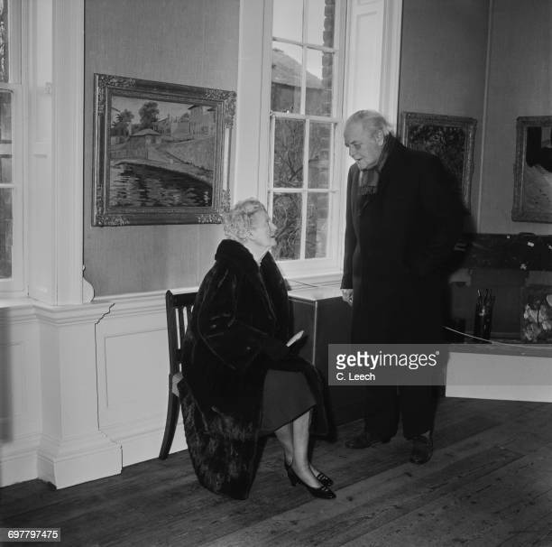 Randolph Churchill the son of Winston Churchill with his mother Clementine Churchill at an exhibition of his father's artworks in Colchester UK 1st...