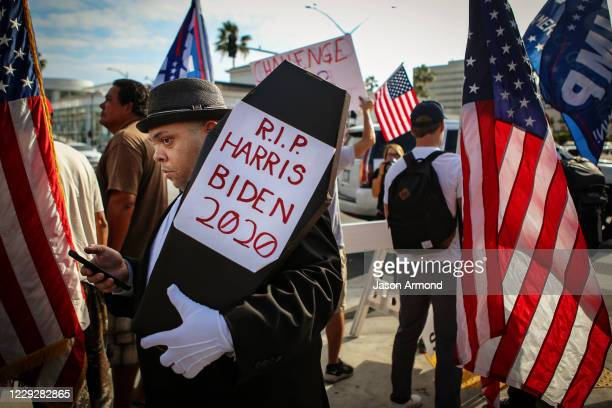 Randolph Grant of Culver City holds a coffin that reads RIP Harris Biden 2020 at the USA Freedom Rally were Trump supporters rallied in Beverly...