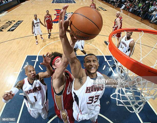 Randolph Morris of the Atlanta Hawks rebounds against Anderson Varejao of the Cleveland Cavaliers on April 14 2010 at Philips Arena in Atlanta...
