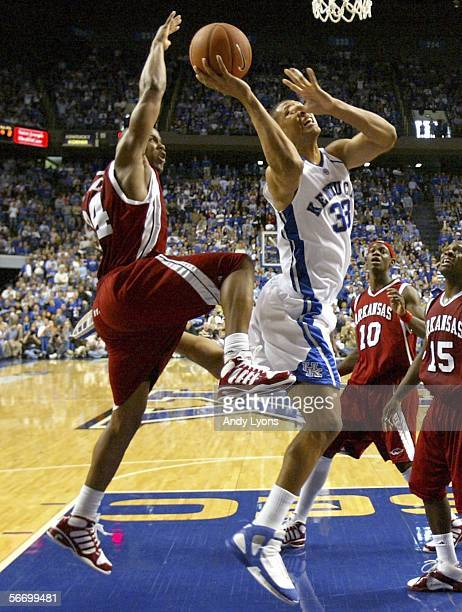 Randolph Morris of the Kentucky Wildcats shoots the ball while defended by Jonathon Modica of the Arkansas Razorbacks during the SEC game on January...