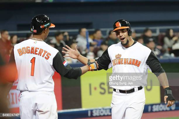 Randolph Oduber celebrates with Xander Bogaerts of the Netherlands after scoring in the second inning during the World Baseball Classic Pool A Game...
