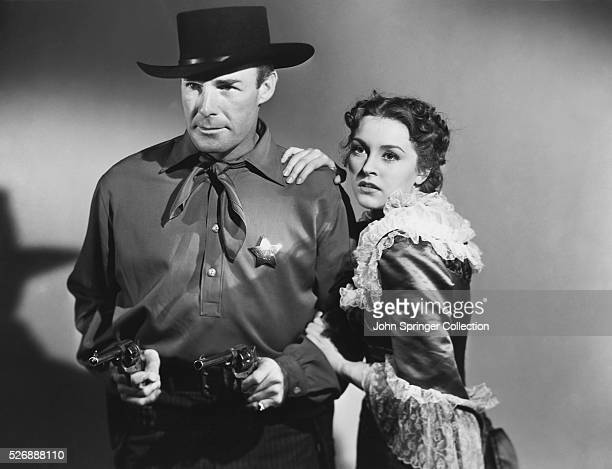 Randolph Scott and Nancy Kelly costar in the 1939 western Frontier Marshal playing the respective roles of Wyatt Earp and Sarah Allen