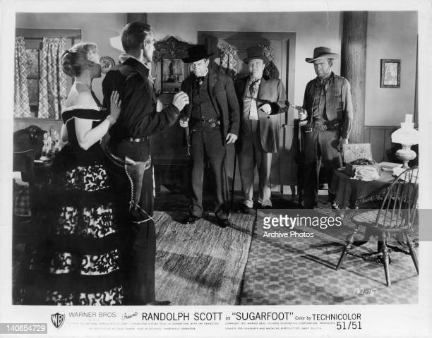 Randolph Scott with others in a scene from the film 'Sugarfoot' 1950
