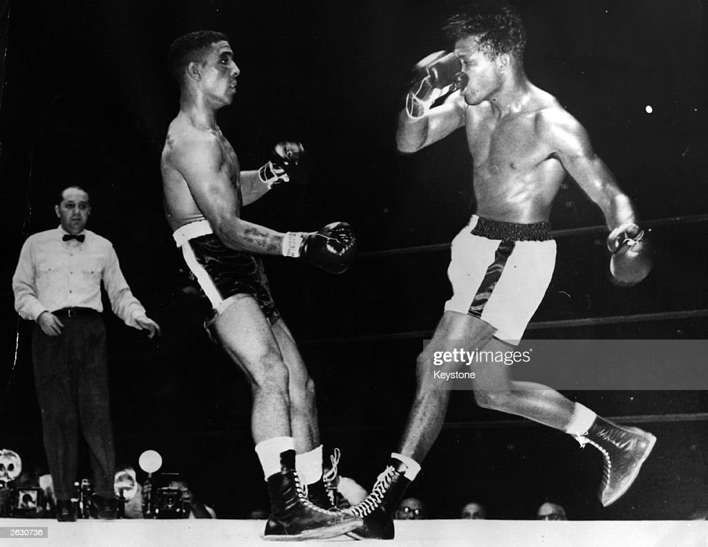 Randolph Turpin, English middleweight boxer and British and European champion, just before the fight was stopped to save him from any further damage. Sugar Ray Robinson is on the right having just landed his final punch.