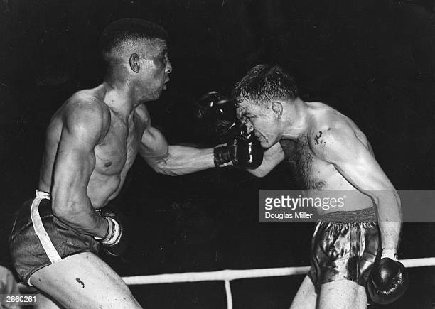 Randolph Turpin lands a straight left on to Charles Humez's nose during their fight at London's White City