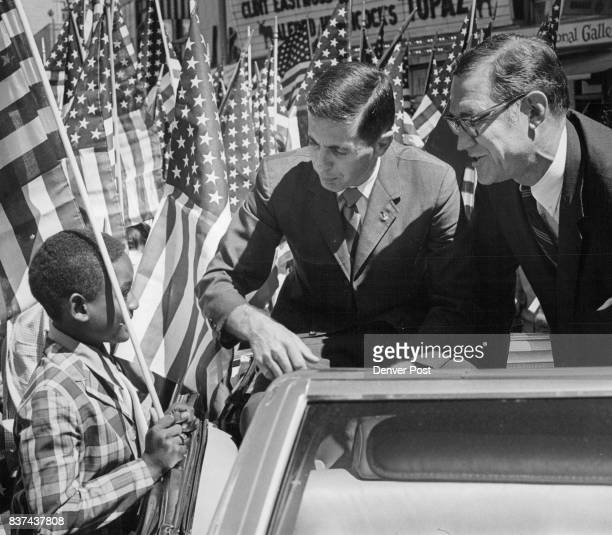 Randolph White of 3695 Detroit St one of the 500 Denver area school children who marched chats with astronaut William Anders center and US Rep Don...