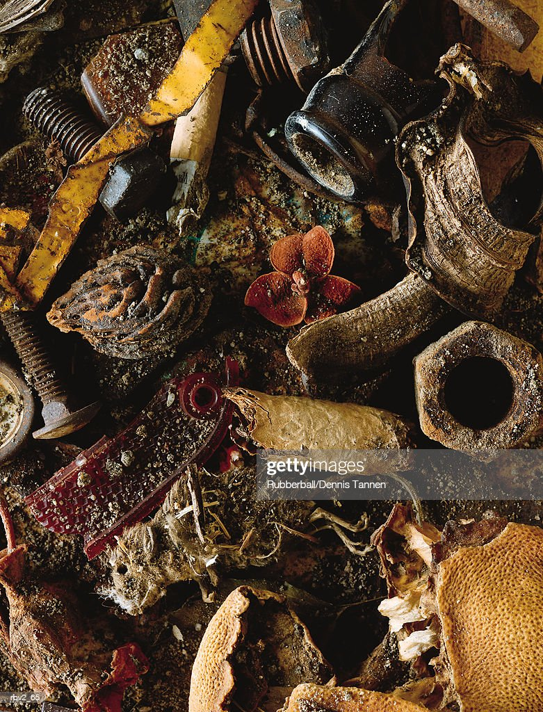 random articles including nuts and bolts lie in a pile of garbage : Foto de stock