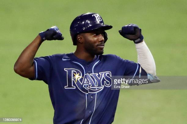 Randy Arozarena of the Tampa Bay Rays celebrates a single against the Houston Astros during the ninth inning in Game Three of the American League...