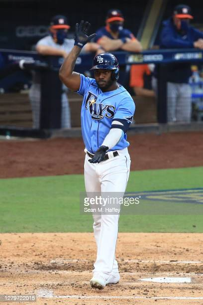 Randy Arozarena of the Tampa Bay Rays celebrates as he crosses home plate after hitting a solo home run against the Houston Astros during the fourth...