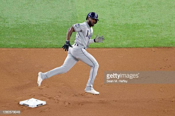 Randy Arozarena of the Tampa Bay Rays celebrates as he rounds the bases after hitting a solo home run against the Los Angeles Dodgers during the...