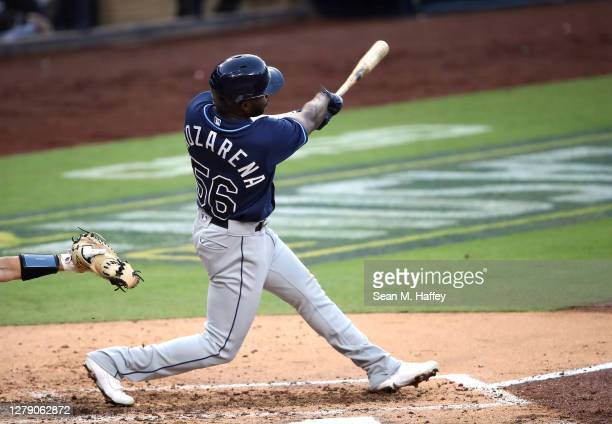 Randy Arozarena of the Tampa Bay Rays hits a solo home run against the New York Yankees during the fifth inning in Game Three of the American League...