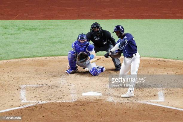 Randy Arozarena of the Tampa Bay Rays hits a solo home run against the Los Angeles Dodgers during the fourth inning in Game Four of the 2020 MLB...