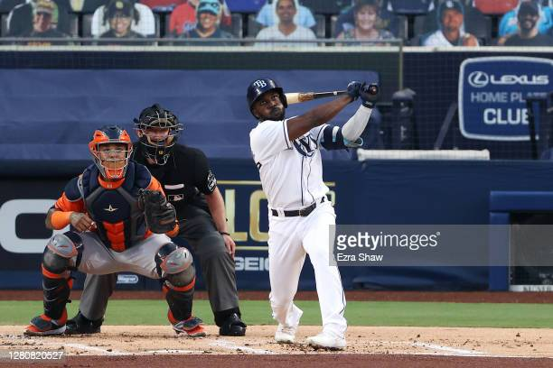 Randy Arozarena of the Tampa Bay Rays hits a two run home run against the Houston Astros during the first inning in Game Seven of the American League...