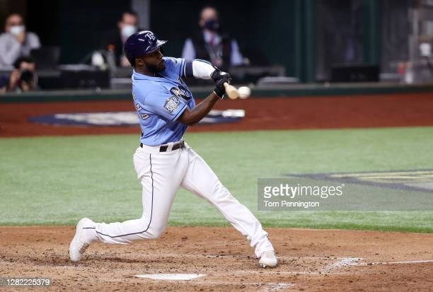 Randy Arozarena of the Tampa Bay Rays hits an RBI single against the Los Angeles Dodgers during the third inning in Game Five of the 2020 MLB World...