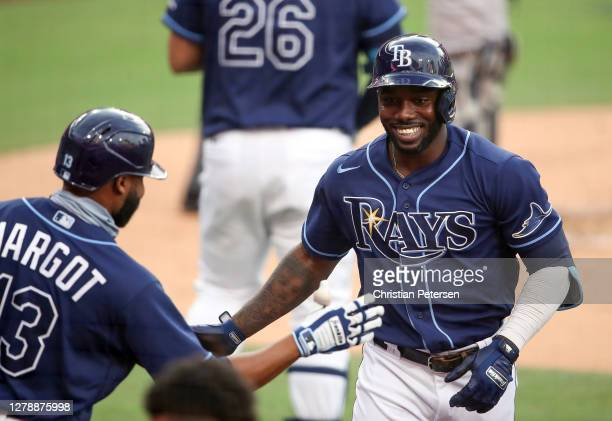 Randy Arozarena of the Tampa Bay Rays is congratulated by Manuel Margot after hitting a solo home run against the New York Yankees during the first...
