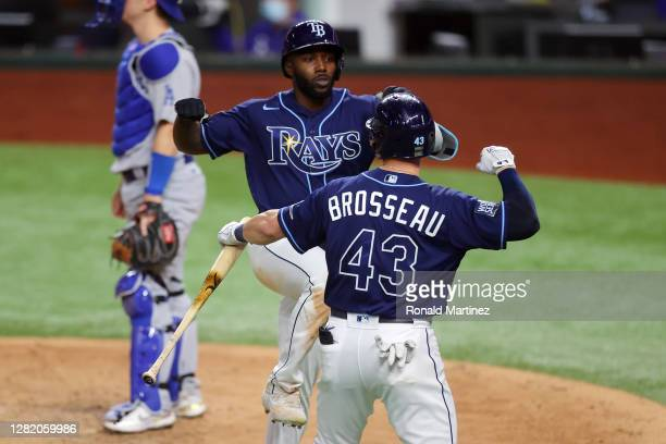 Randy Arozarena of the Tampa Bay Rays is congratulated by Michael Brosseau after hitting a solo home run against the Los Angeles Dodgers during the...