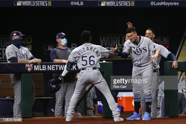 Randy Arozarena of the Tampa Bay Rays is congratulated by Willy Adames after hitting a solo home run against the Los Angeles Dodgers during the first...