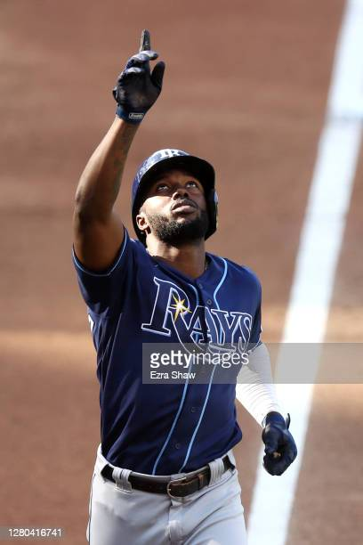 Randy Arozarena of the Tampa Bay Rays points to the sky after hitting a solo home run against the Houston Astros during the fifth inning in Game Five...