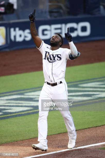 Randy Arozarena of the Tampa Bay Rays points to the sky as he celebrates a two run home run against the Houston Astros during the first inning in...