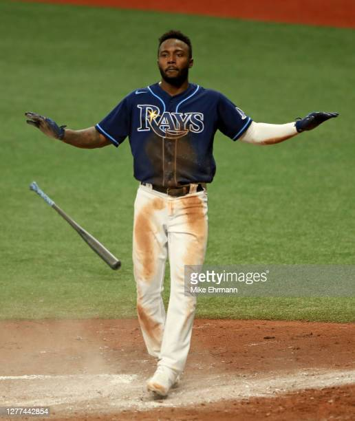 Randy Arozarena of the Tampa Bay Rays reacts to scoring a run on a passed ball in the fourth inning during the Wild Card Round Game One against the...