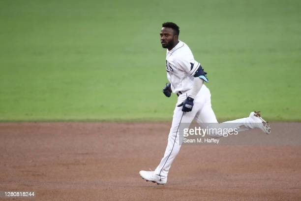 Randy Arozarena of the Tampa Bay Rays rounds the bases after hitting a two run home run against the Houston Astros during the first inning in Game...