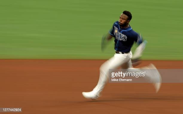 Randy Arozarena of the Tampa Bay Rays runs to third base on a triple in the fourth inning during the Wild Card Round Game One against the Toronto...