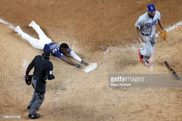 Randy Arozarena of the Tampa Bay Rays slides into home plate during the ninth inning to score the game winning run to give his team the 8-7 victory...