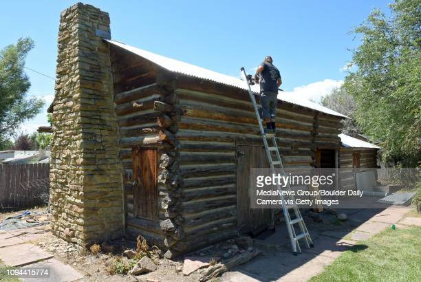 Randy Barquist of Randy's Unique Builders Roofing puts a new roof on the Affolter Cabin in Old Mill Park 237 Pratt St Tuesday Old Mill Park is...