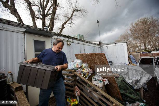 Randy Boheim is packing up his tools and emergency supplies in anticipation of having to evacuate his whole family as flood water slowly creeps...