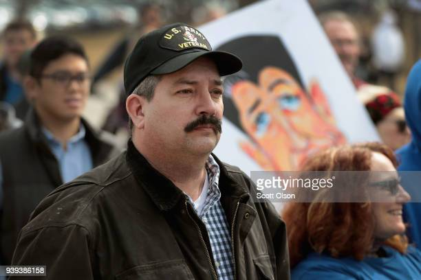 Randy Bryce joins other residents at a rally to show support for students who finished the last leg of a 50mile march through Wisconsin in the...