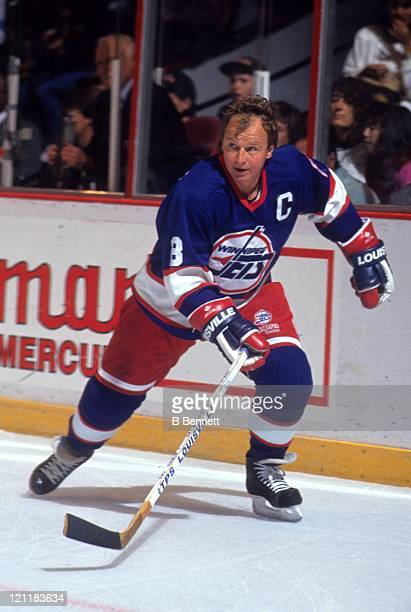 Randy Carlyle of the Winnipeg Jets skates on the ice during an NHL game against the Philadelphia Flyers circa 1990 at the Spectrum in Philadelphia,...