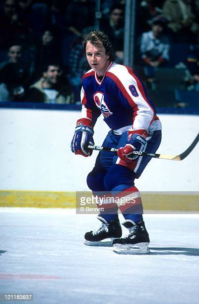 Randy Carlyle of the Winnipeg Jets skates on the ice during an NHL game against the New York Islanders circa 1987 at the Nassau Coliseum in Uniondale...