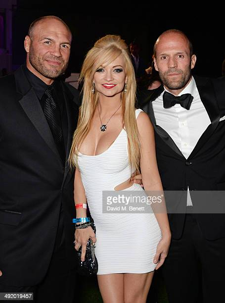 Randy Couture Mindy Robinson and Jason Statham attends The Expendables 3 private dinner and party at Gotha Night Club at Palm Beach on May 18 2014 in...