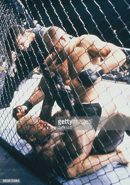Randy Couture punches Kevin Randleman during the UFC 28 High Stakes event inside the Trump Taj Mahal on November 17 2000 in Atlantic City New Jersey