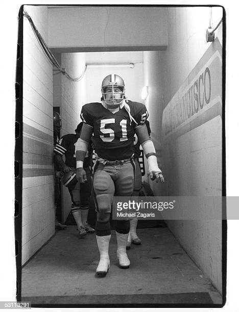 Randy Cross of the San Francisco 49ers walks out of the locker room during the1983 NFC Championship game against the Washington Redskins at RFK...