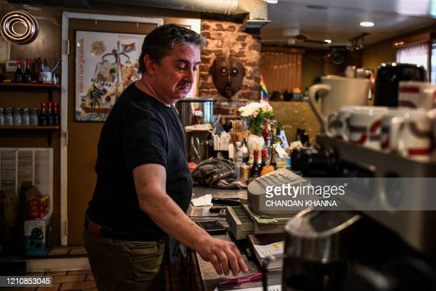 Randy D Adler works at his restaurant in Atlanta Georgia on April 23 2020 The US state of Georgia takes a massive gamble on April 24 when it allows...