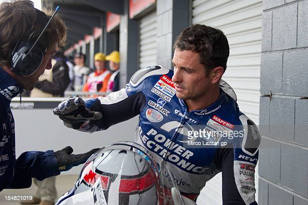 Randy De Puniet of France and Power Electronics Aspar celebrates with mechanic the CRT pole position at the end of the qualifying for the Australian...