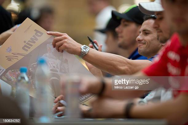 Randy De Puniet of France and Power Electronics Aspar signs autographs for fans during the preevent QA and autograph session in Vankovka Mall in Brno...